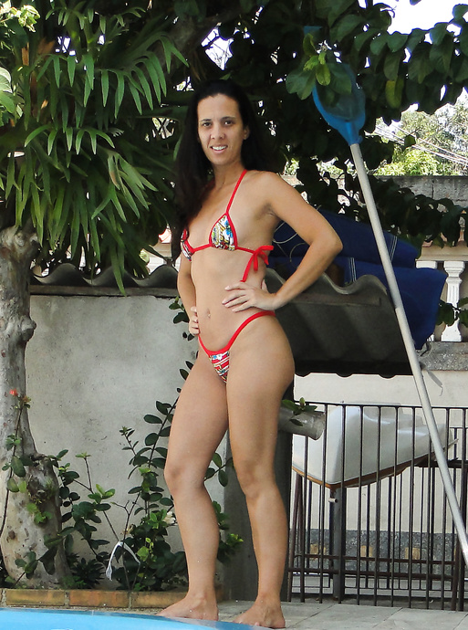 The biggest brazilian slut wearing a small bikini to cover up her sexy body